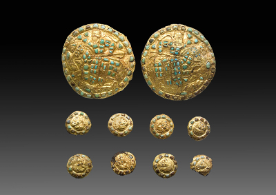 A set of horse phalerae with a battle scene